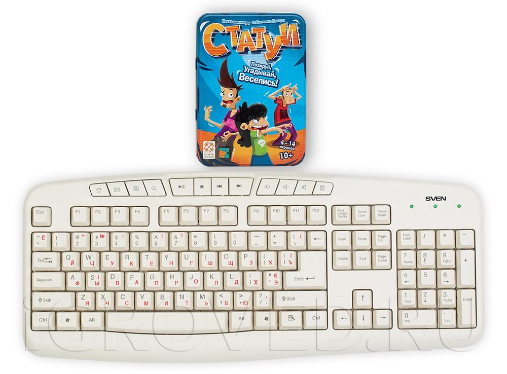 Коробка настольной игры Статуи в сравнении с клавиатурой