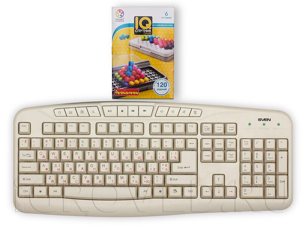 Коробка настольной игры IQ-Спутник гения в сравнении с клавиатурой
