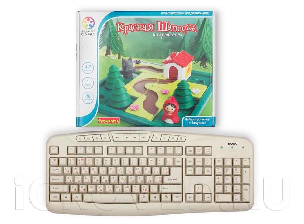 Коробка настольной игры-головоломки Красная Шапочка и Серый волк в сравнении с клавиатурой