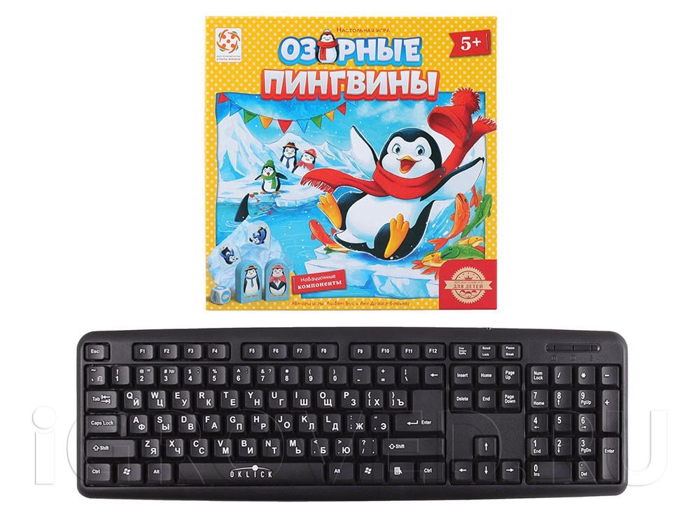 Коробка настольной игры Озорные пингвины в сравнении с клавиатурой
