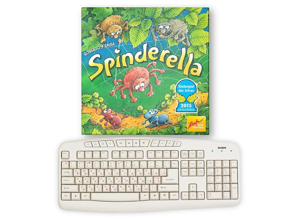 Коробка настольной игры Спиндерелла (Spinderella) с равнении с клавиатурой