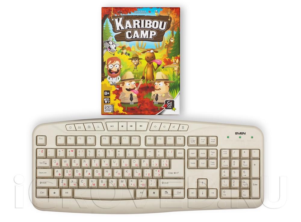 Коробка настольной игры Лагерь Карибу (Кaribou Camp) в сравнении с клавиатурой
